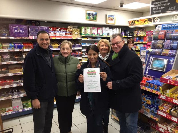 Awarding Wednesfield in Bloom 'Thank You certificates, Nisa , Ashmore Park. Taking part in a Community venture.