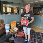 """""Here Kevin Ward receives a donation of foods, and other items like toiletries."